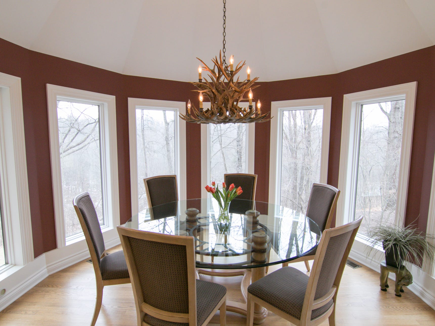 A custom chandelier hangs over a dining space adjoining the kitchen in the Cross Creek Drive home, shown Thursday, Jan. 17, 2019.