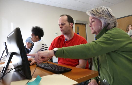 Career coach Donna Blevens, right, assists Michael Winchester with employment placement support at Goodwill. Jan. 25, 2019