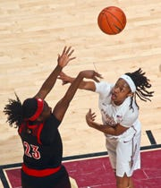Louisville guard Jazmine Jones (23) shoots over Florida State guard Nicole Ekhomu (12) during the first half of an NCAA college basketball game in Tallahassee, Fla., Thursday, Jan. 24, 2019.