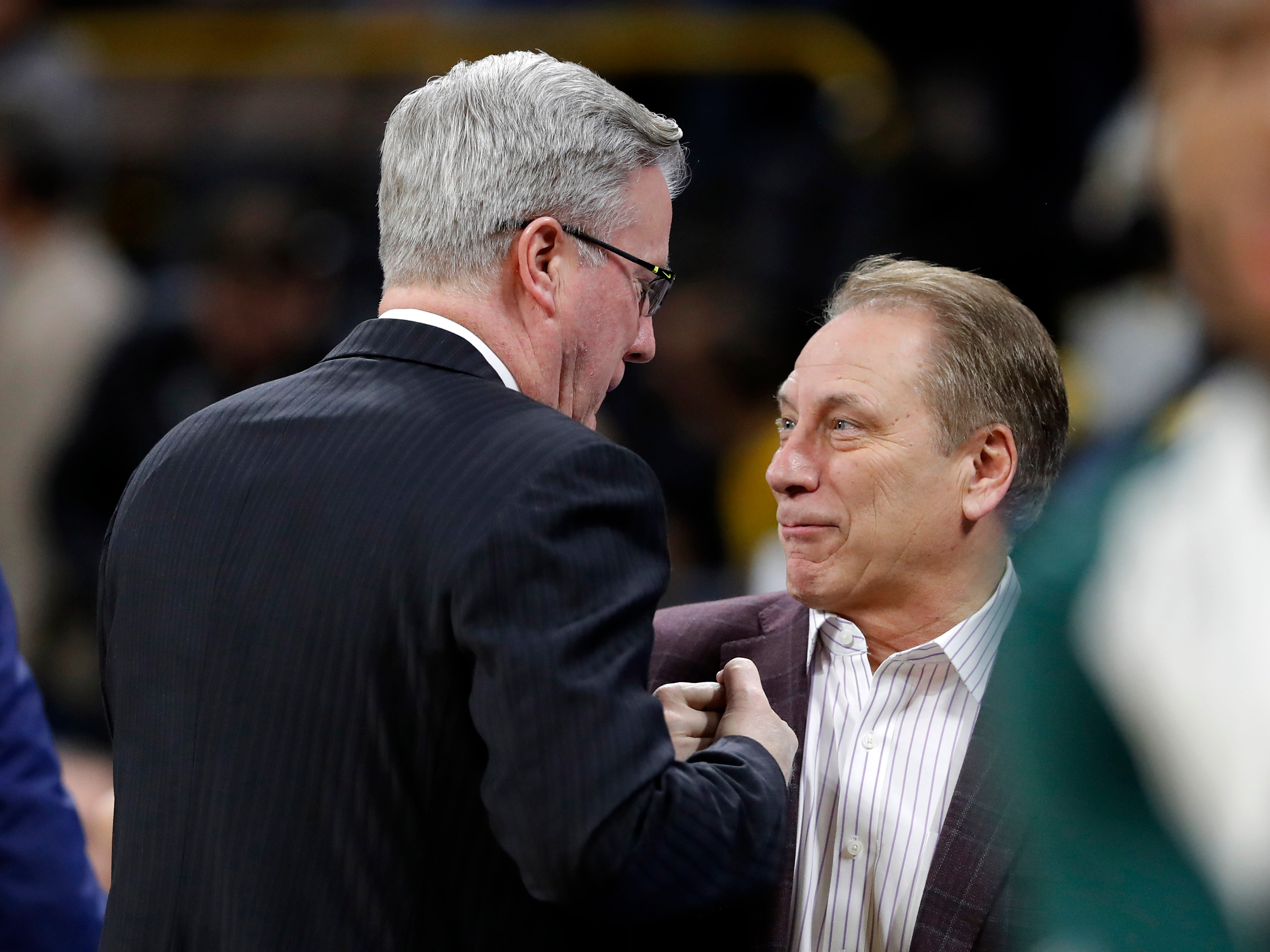 Iowa coach Fran McCaffery, left, talks with Michigan State coach Tom Izzo before an NCAA college basketball game Thursday, Jan. 24, 2019, in Iowa City, Iowa.