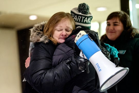 """Valerie von Frank, left, hugs ReclaimMSU's Mackenzie Mrla after speaking during the """"One Year On: Celebrating Courage and Creating Change"""" event on Thursday, Jan. 24, 2019, outside the Hannah Administration Building on the Michigan State University campus in East Lansing. Valerie's daughter, Grace French, is a survivor of Larry Nassar's abuse. The event was organized by Reclaim MSU and held on the one-year anniversary of Larry Nassar's sentencing."""