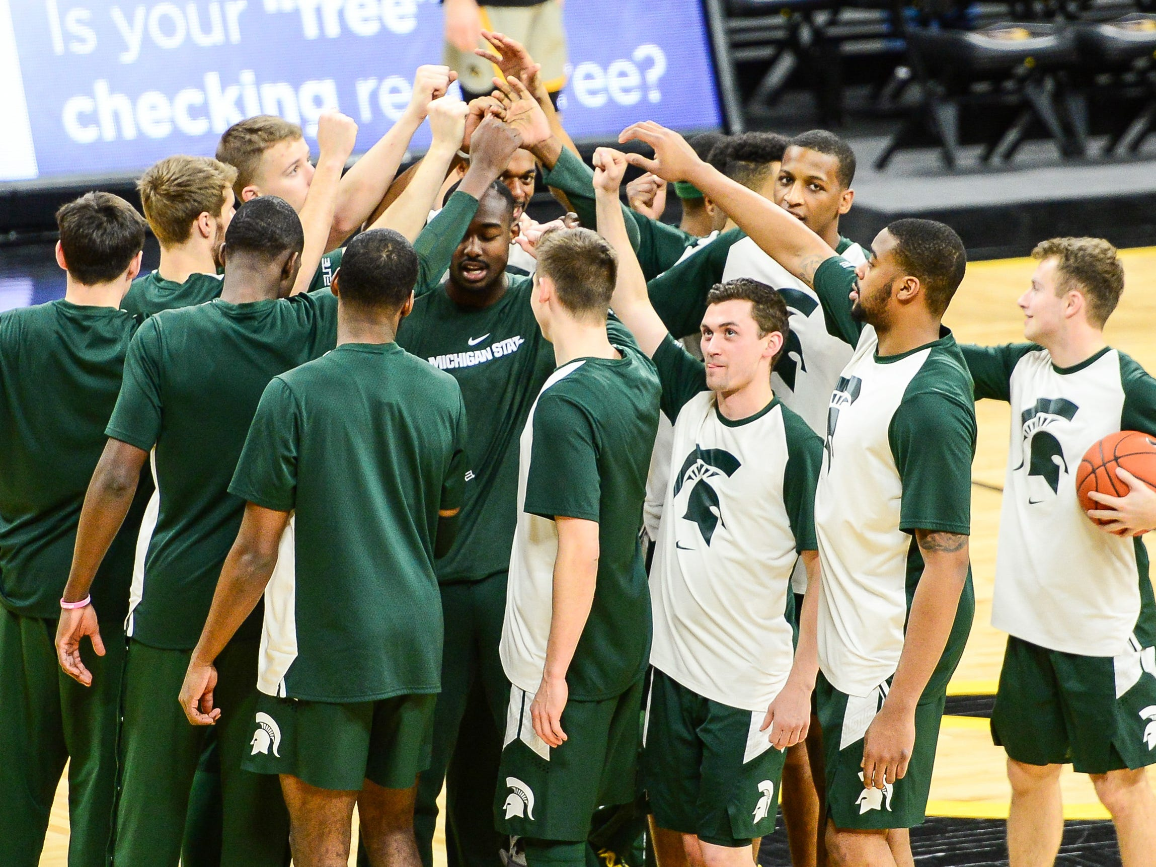 Michigan State Spartans player huddle on court prior to their game against the Iowa Hawkeyes at Carver-Hawkeye Arena.
