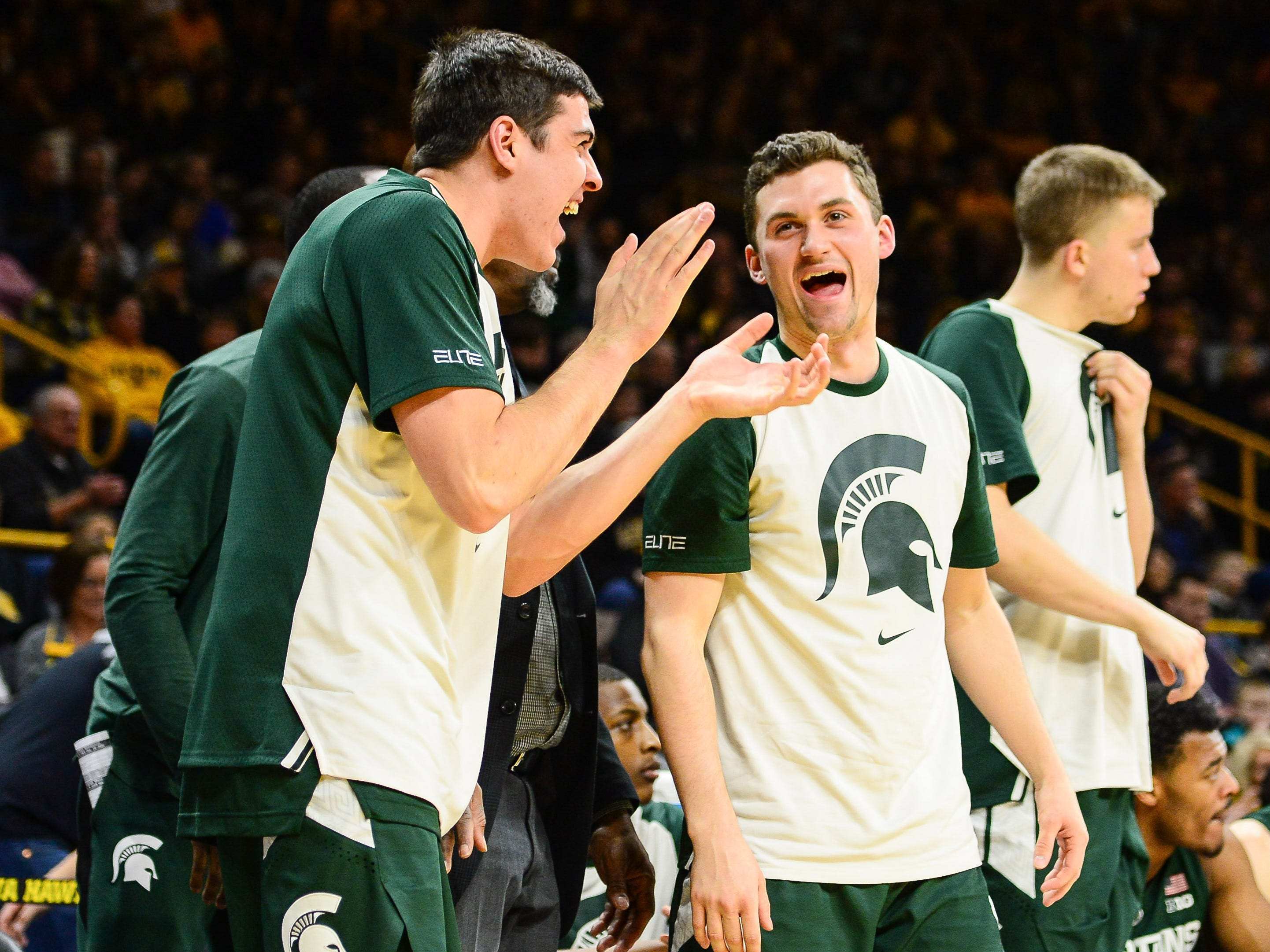 Michigan State Spartans players celebrate on the bench during the second half against the Iowa Hawkeyes at Carver-Hawkeye Arena.