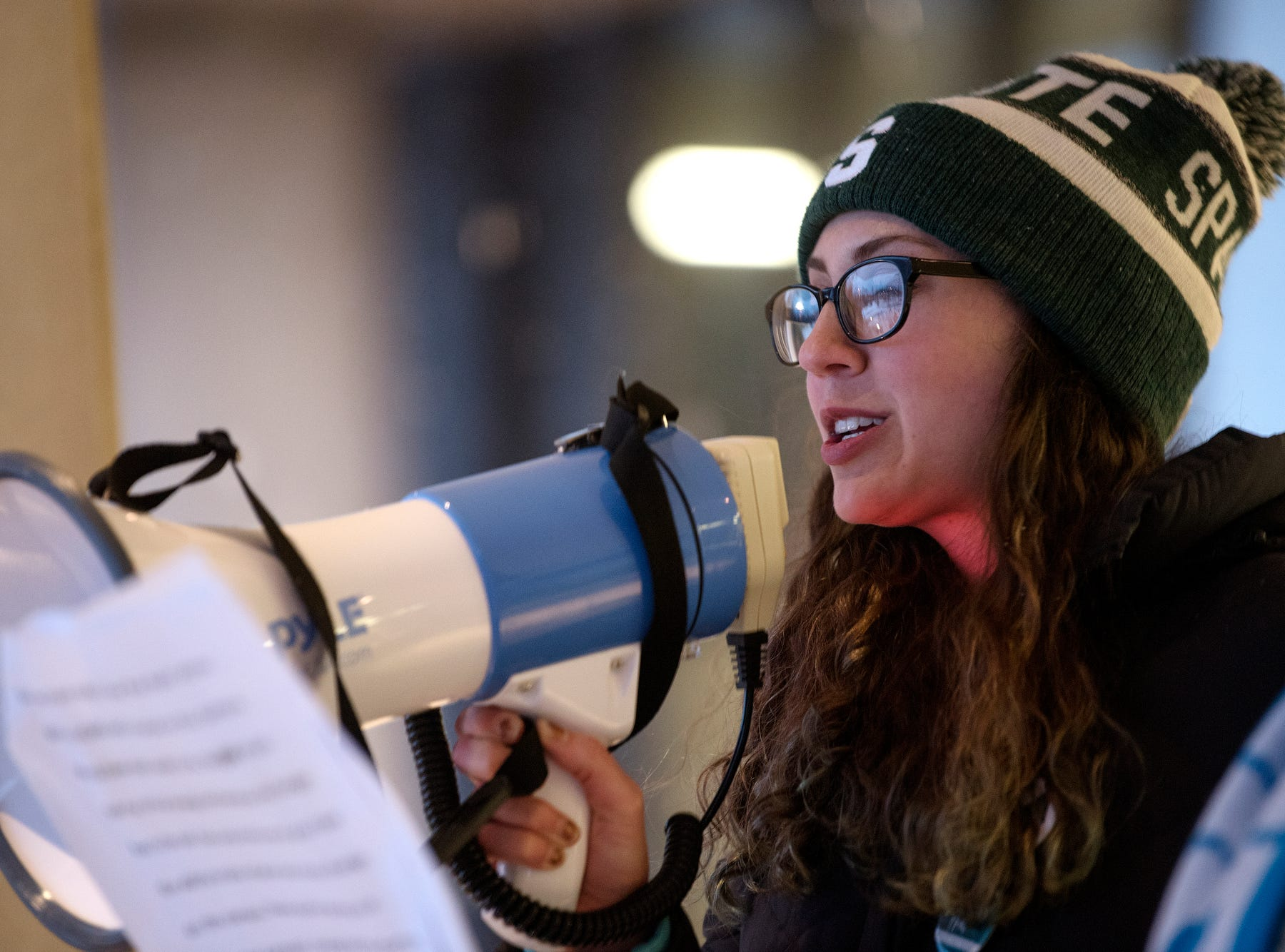 "ReclaimMSU's Mackenzie Mrla speaks during the ""One Year On: Celebrating Courage and Creating Change"" event on Thursday, Jan. 24, 2019, outside the Hannah Administration Building on the Michigan State University campus in East Lansing. The event was organized by Reclaim MSU and held on the one-year anniversary of Larry Nassar's sentencing."