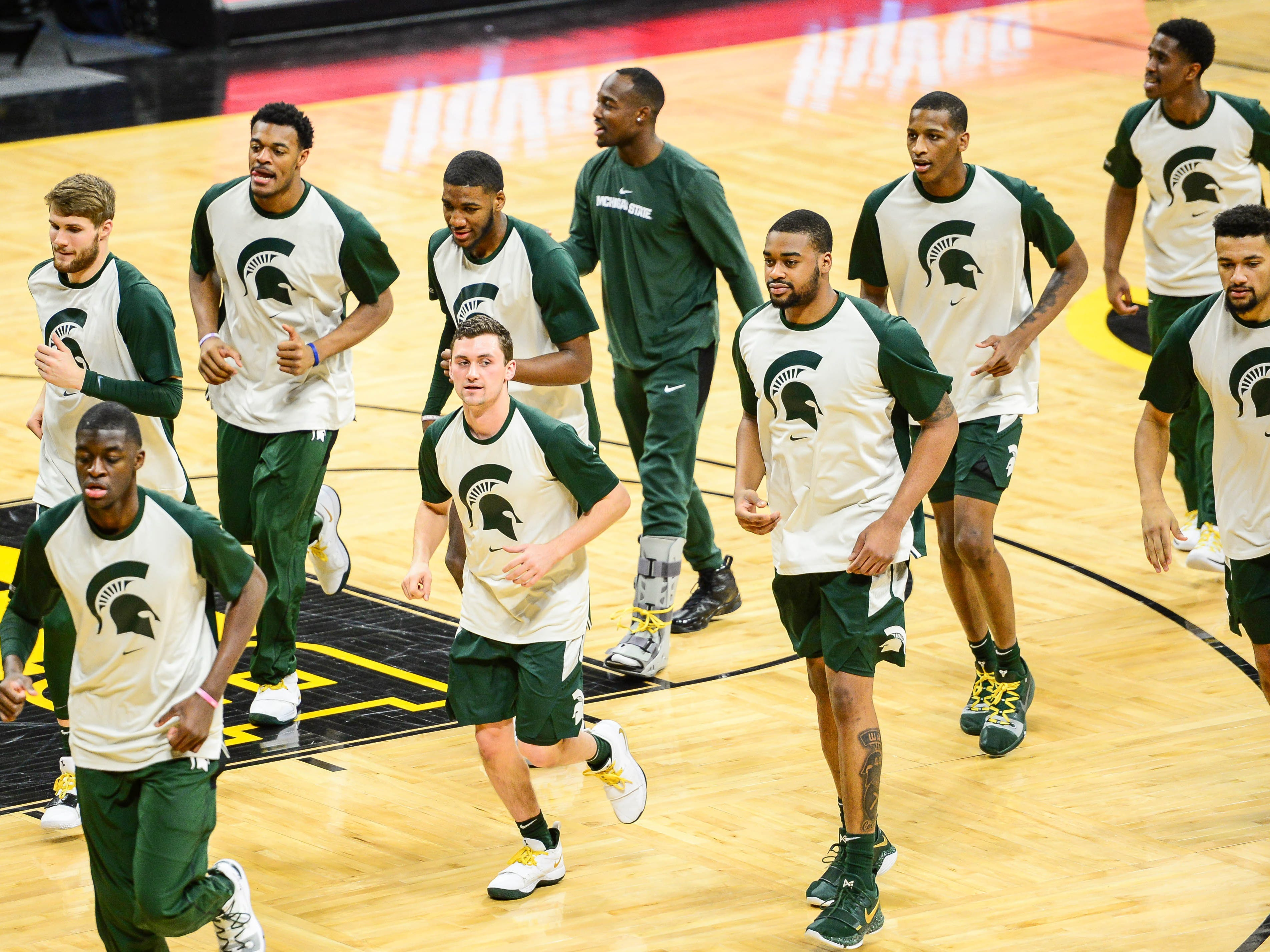 Michigan State Spartans player run off the court prior to their game against the Iowa Hawkeyes at Carver-Hawkeye Arena.