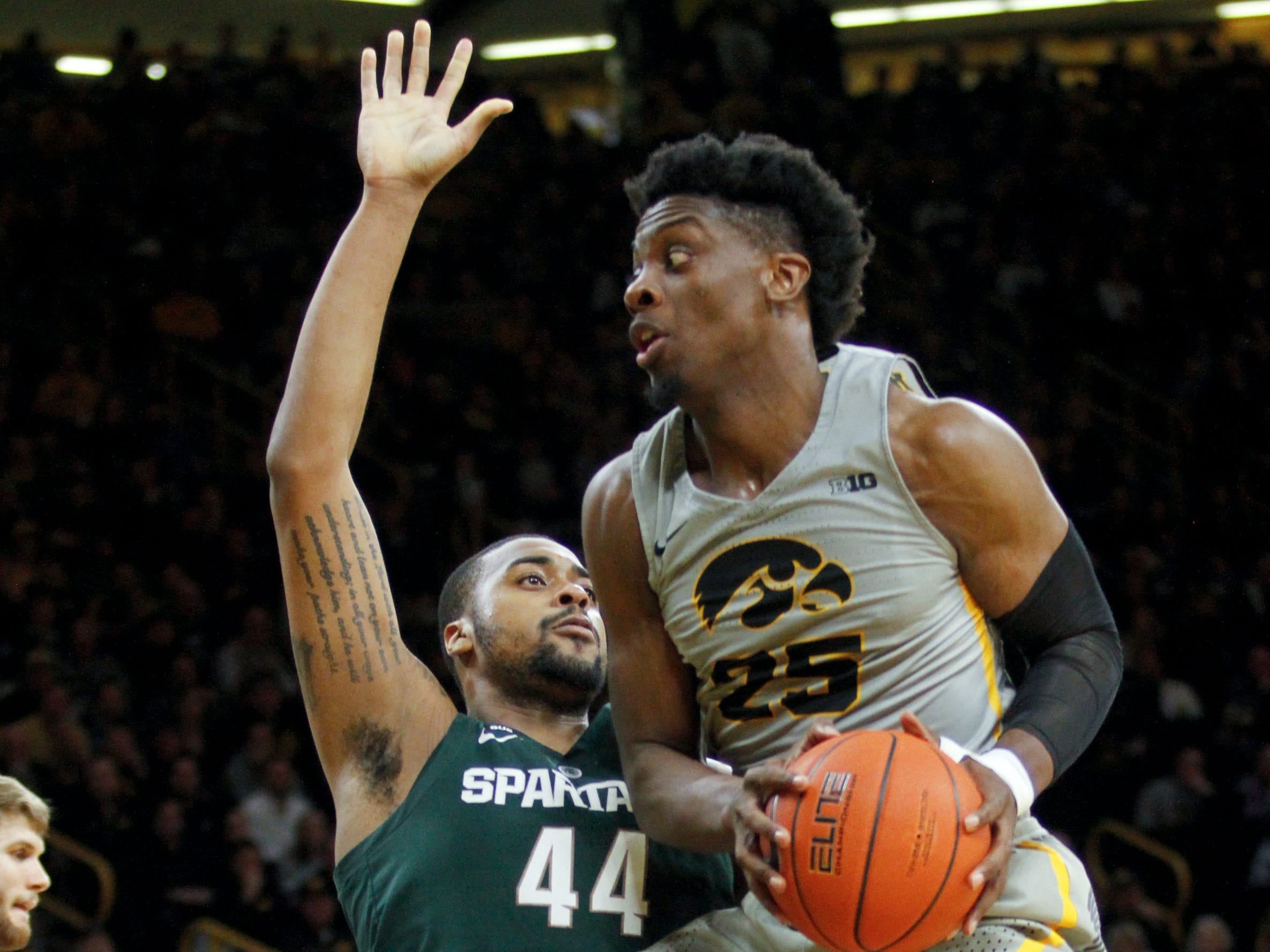 Forward Tyler Cook #25 of the Iowa Hawkeyes goes to the basket in the first half against forward Nick Ward #44 of the Michigan State Spartans on January 24, 2019 at Carver-Hawkeye Arena, in Iowa City, Iowa.