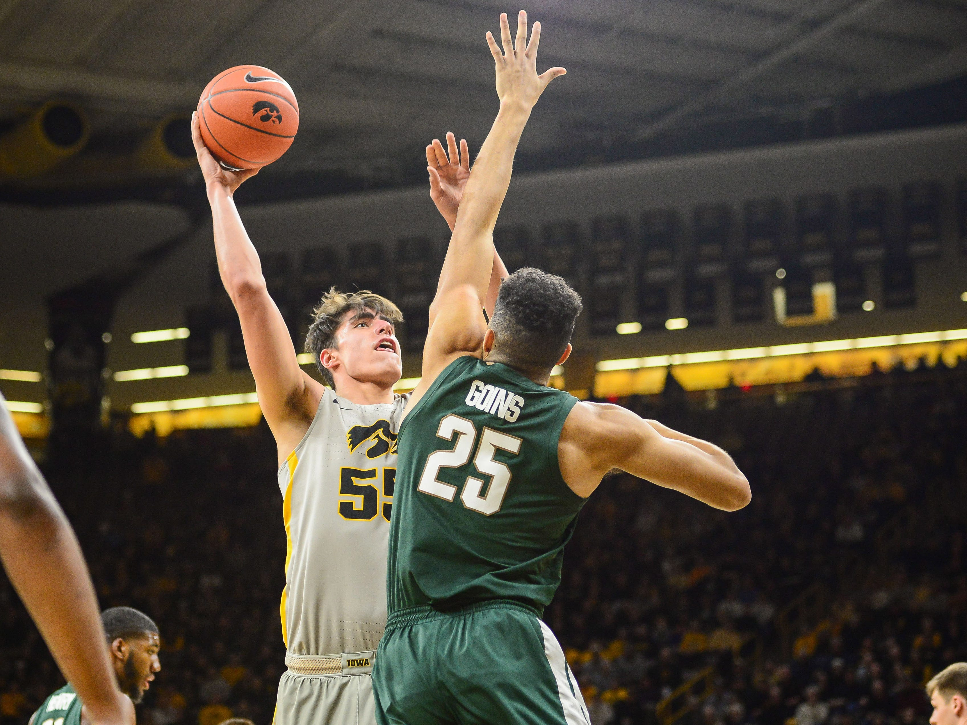 Iowa Hawkeyes forward Luka Garza (55) shoots the ball over Michigan State Spartans forward Kenny Goins (25) during the first half at Carver-Hawkeye Arena.