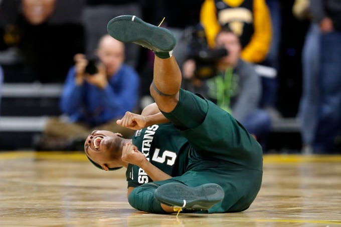 Michigan State guard Cassius Winston celebrates on the court after getting fouled on a three-point shot during the second half of the team's NCAA college basketball game against Iowa, Thursday, Jan. 24, 2019, in Iowa City, Iowa. Michigan State won 82-67.
