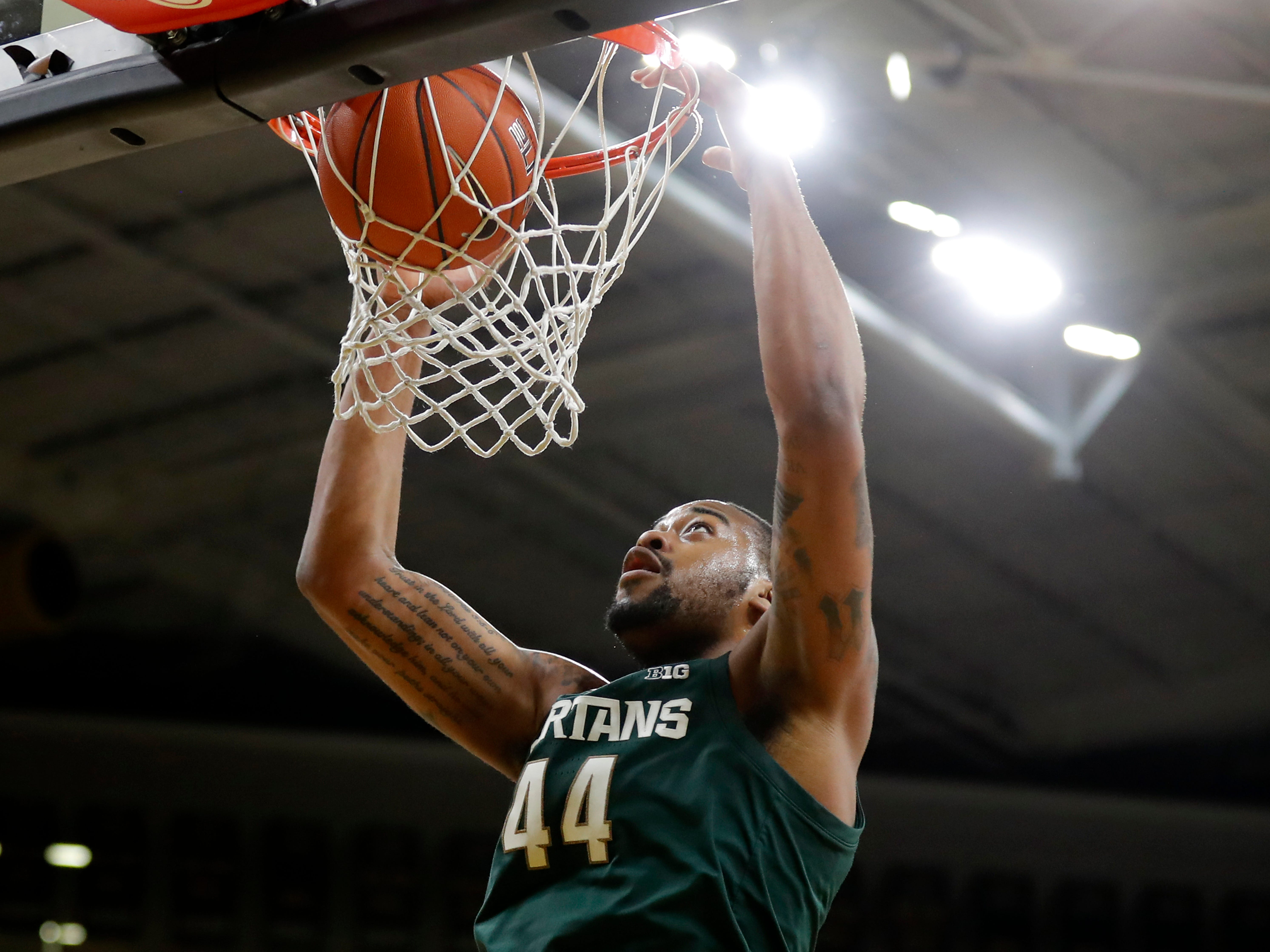 Michigan State forward Nick Ward dunks during the first half of the team's NCAA college basketball game against Iowa, Thursday, Jan. 24, 2019, in Iowa City, Iowa. Michigan State won 82-67.