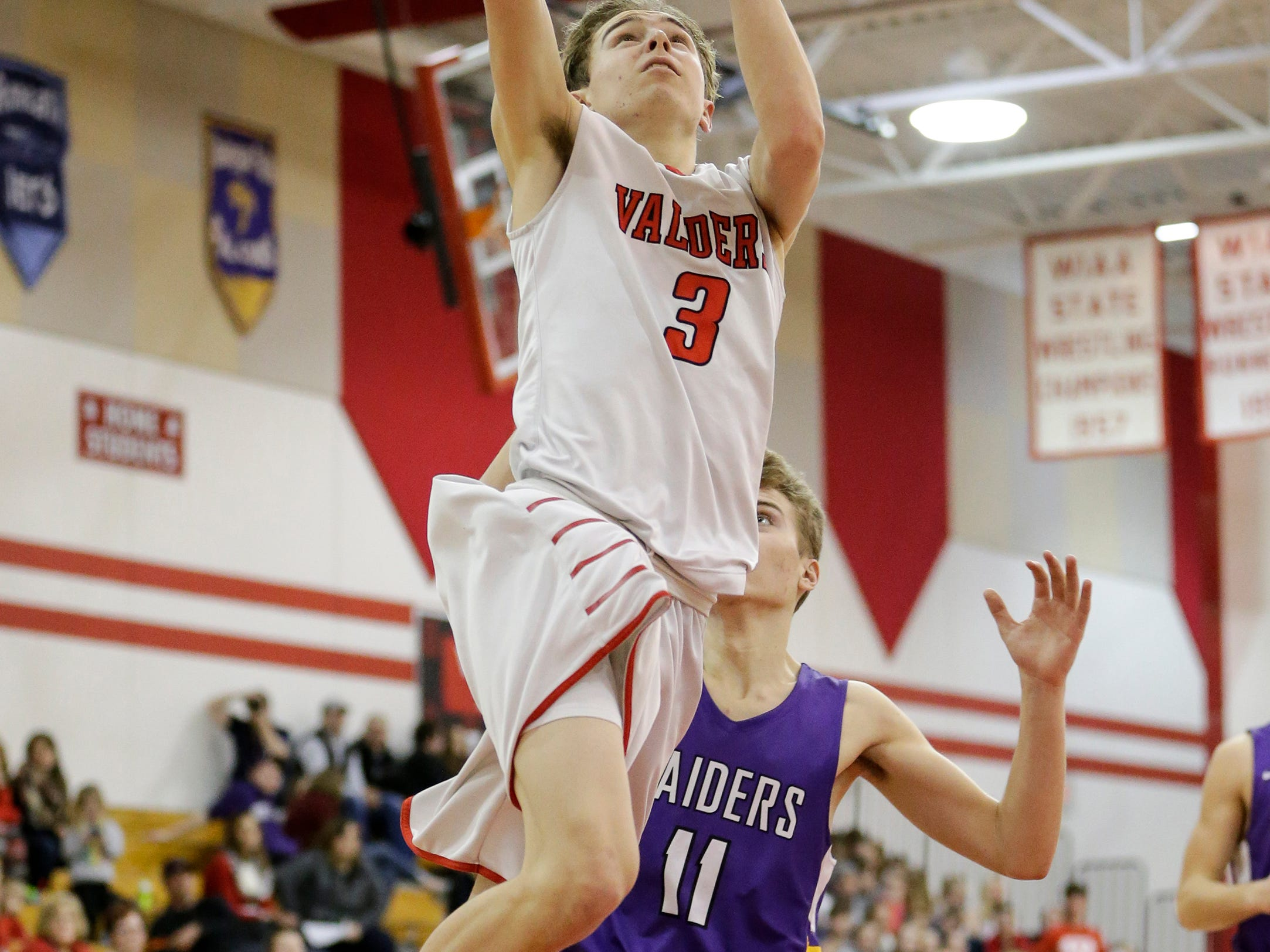Valders' Matthew Meyers (3) drives for a layup against Two Rivers at Valders High School Thursday, January 24, 2019, in Valders, Wis. Joshua Clark/USA TODAY NETWORK-Wisconsin