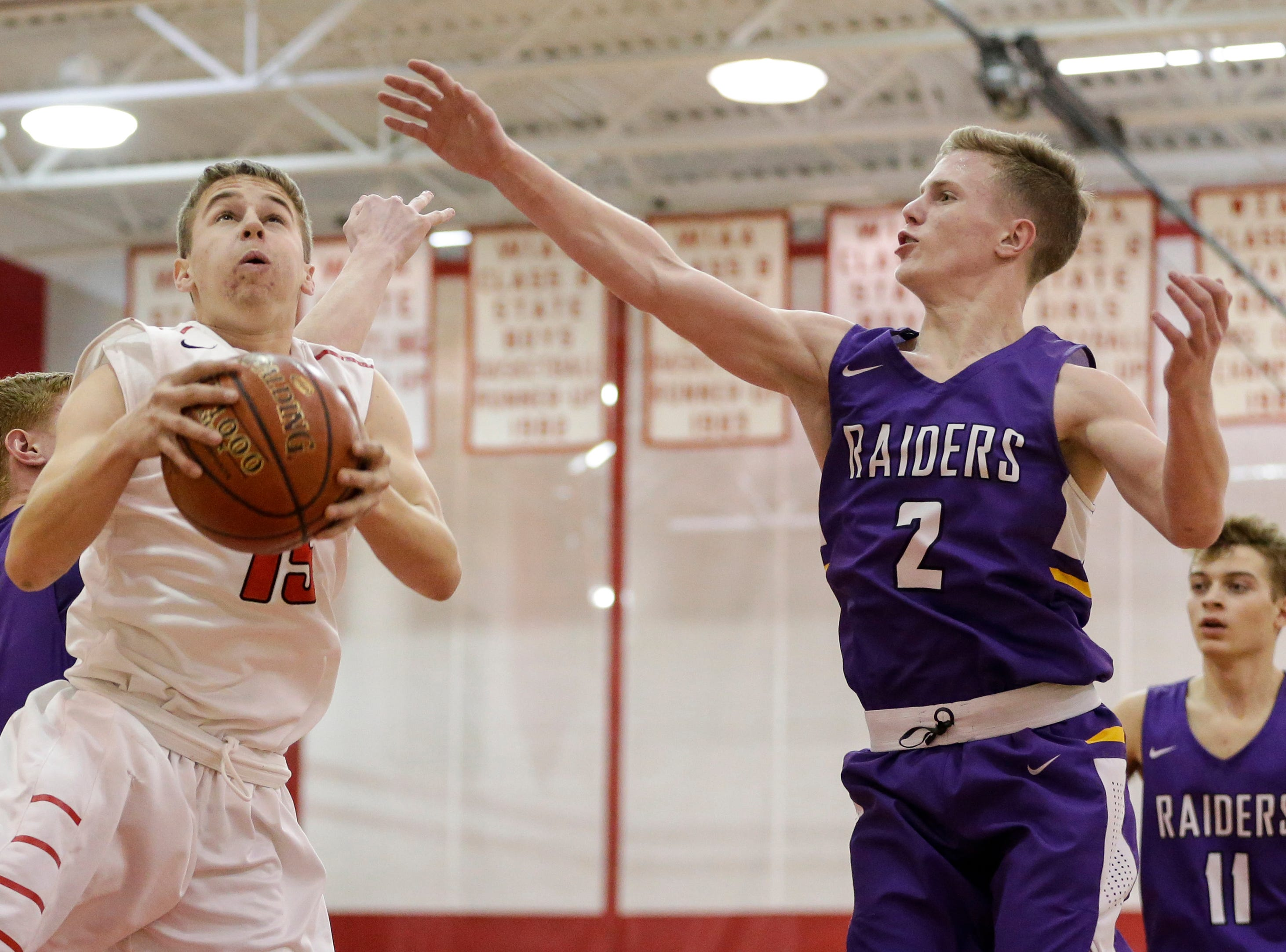 Valders' Brad Otto-Stahl (15) rebounds against Two Rivers' Ethan Limon (2) at Valders High School Thursday, January 24, 2019, in Valders, Wis. Joshua Clark/USA TODAY NETWORK-Wisconsin