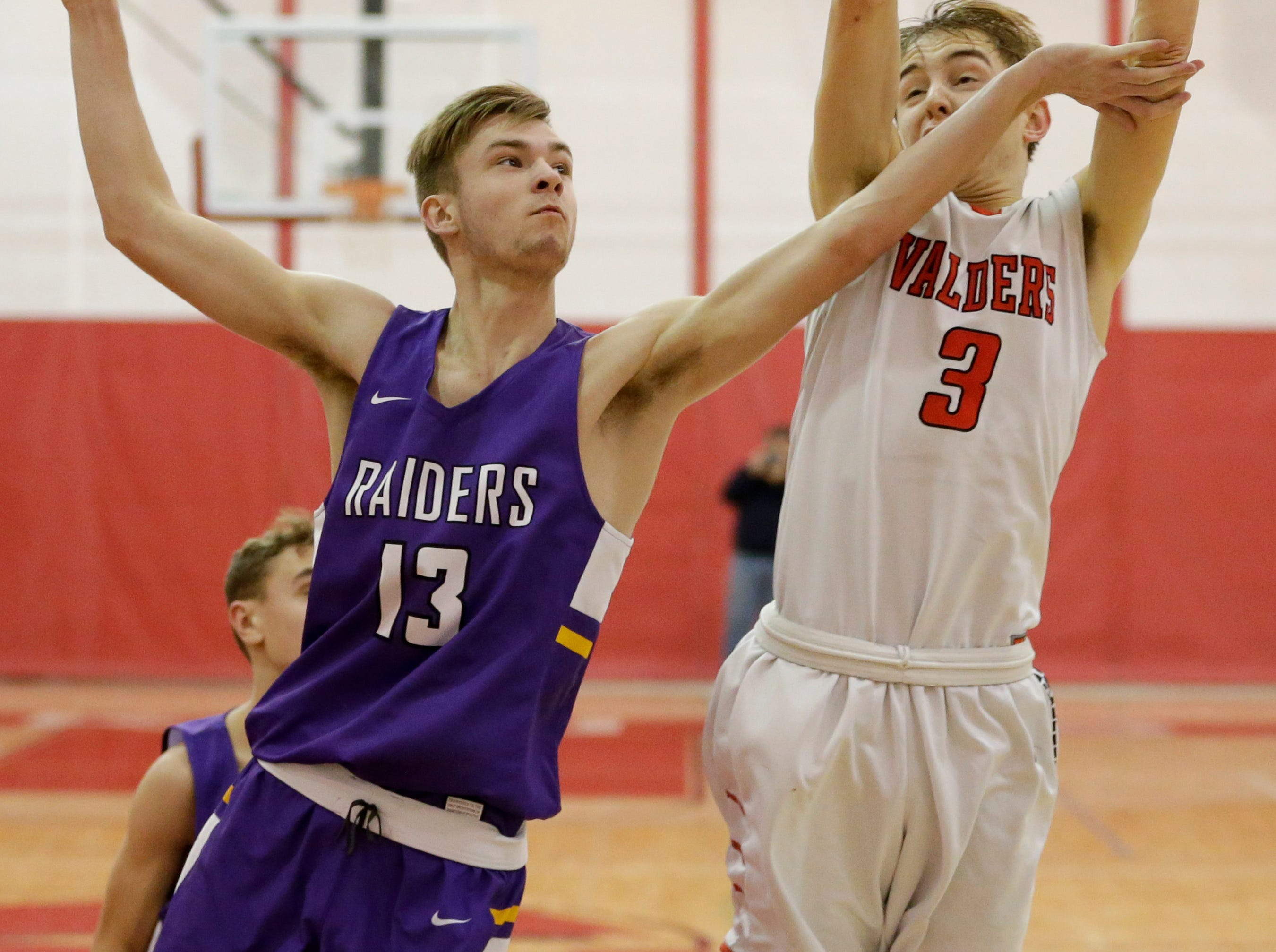 Valders' Matthew Meyers (3) rebounds against Two Rivers' David Tice (13) at Valders High School Thursday, January 24, 2019, in Valders, Wis. Joshua Clark/USA TODAY NETWORK-Wisconsin