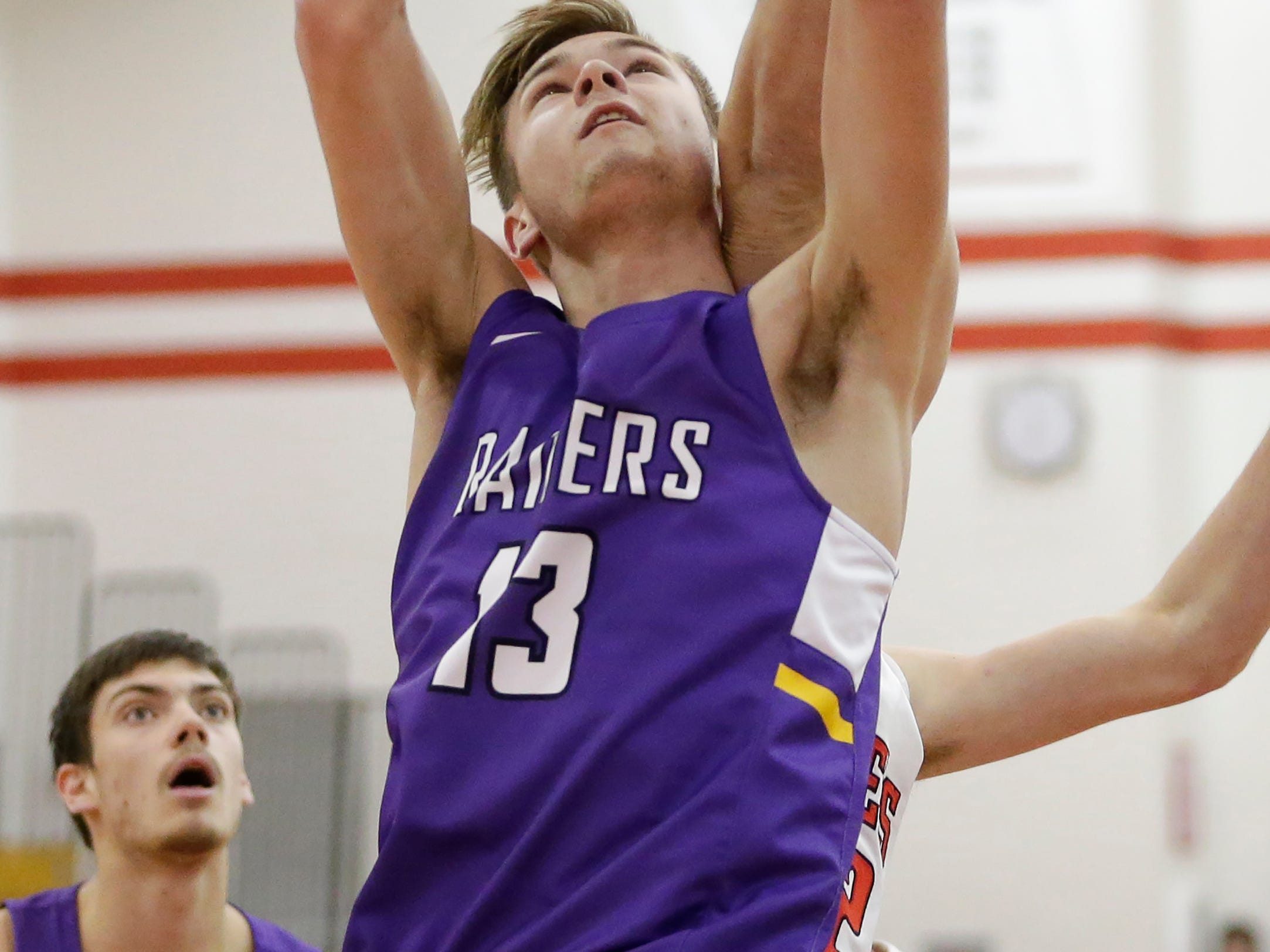 Two Rivers' David Tice (13) rebounds against Valders at Valders High School Thursday, January 24, 2019, in Valders, Wis. Joshua Clark/USA TODAY NETWORK-Wisconsin