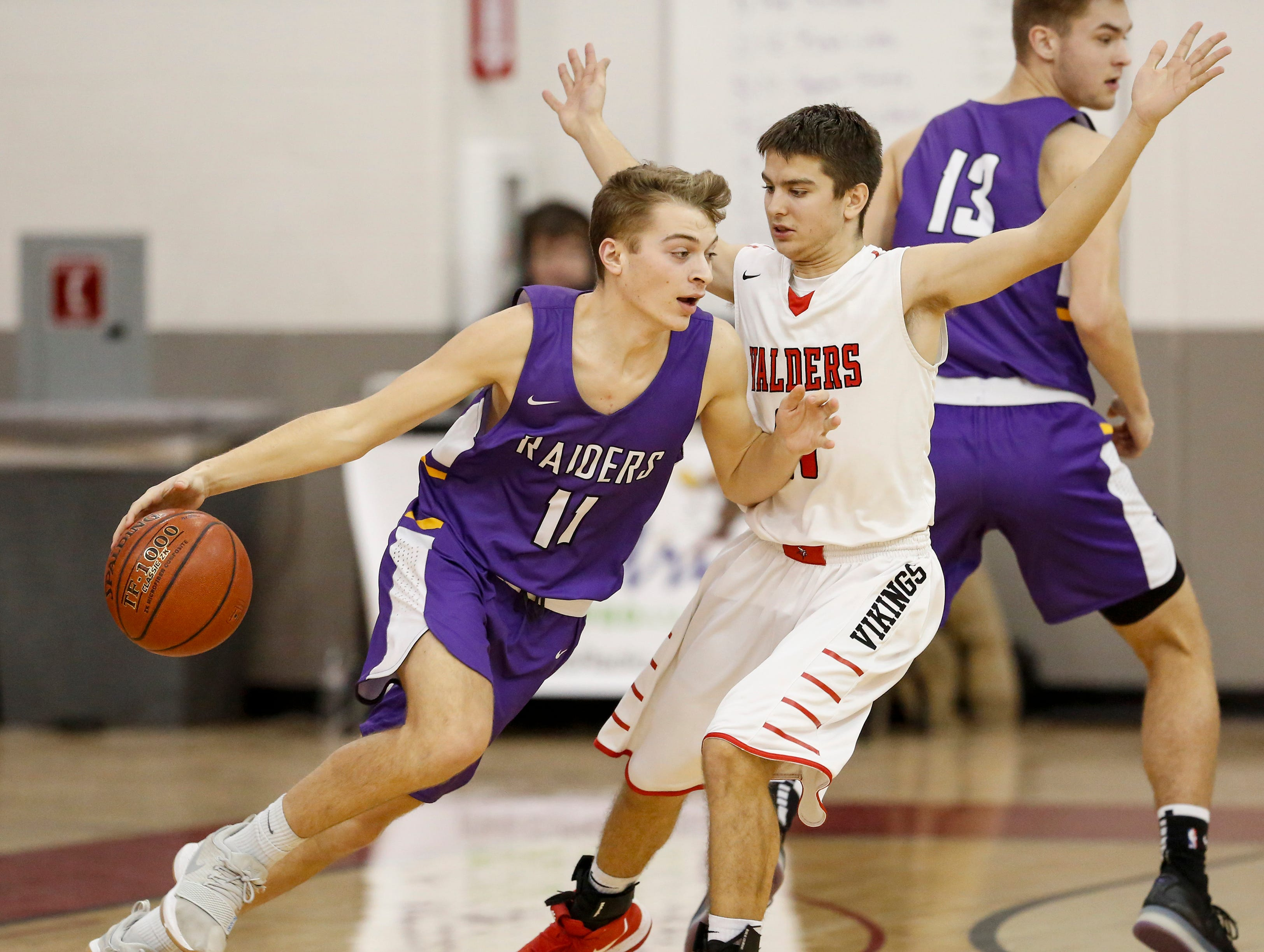 Two Rivers' Alexander Klein (11) drives past Valders' Riley Hammel (11) at Valders High School Thursday, January 24, 2019, in Valders, Wis. Joshua Clark/USA TODAY NETWORK-Wisconsin