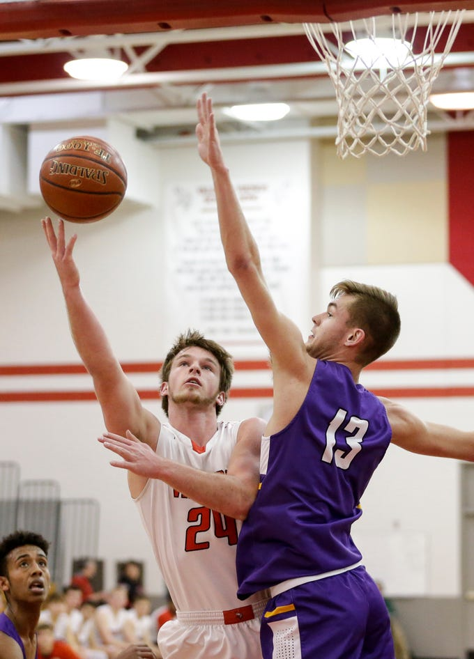 Valders' Fletcher Dallas (24) shoots against Two Rivers' David Tice (13) at Valders High School Thursday, January 24, 2019, in Valders, Wis. Joshua Clark/USA TODAY NETWORK-Wisconsin