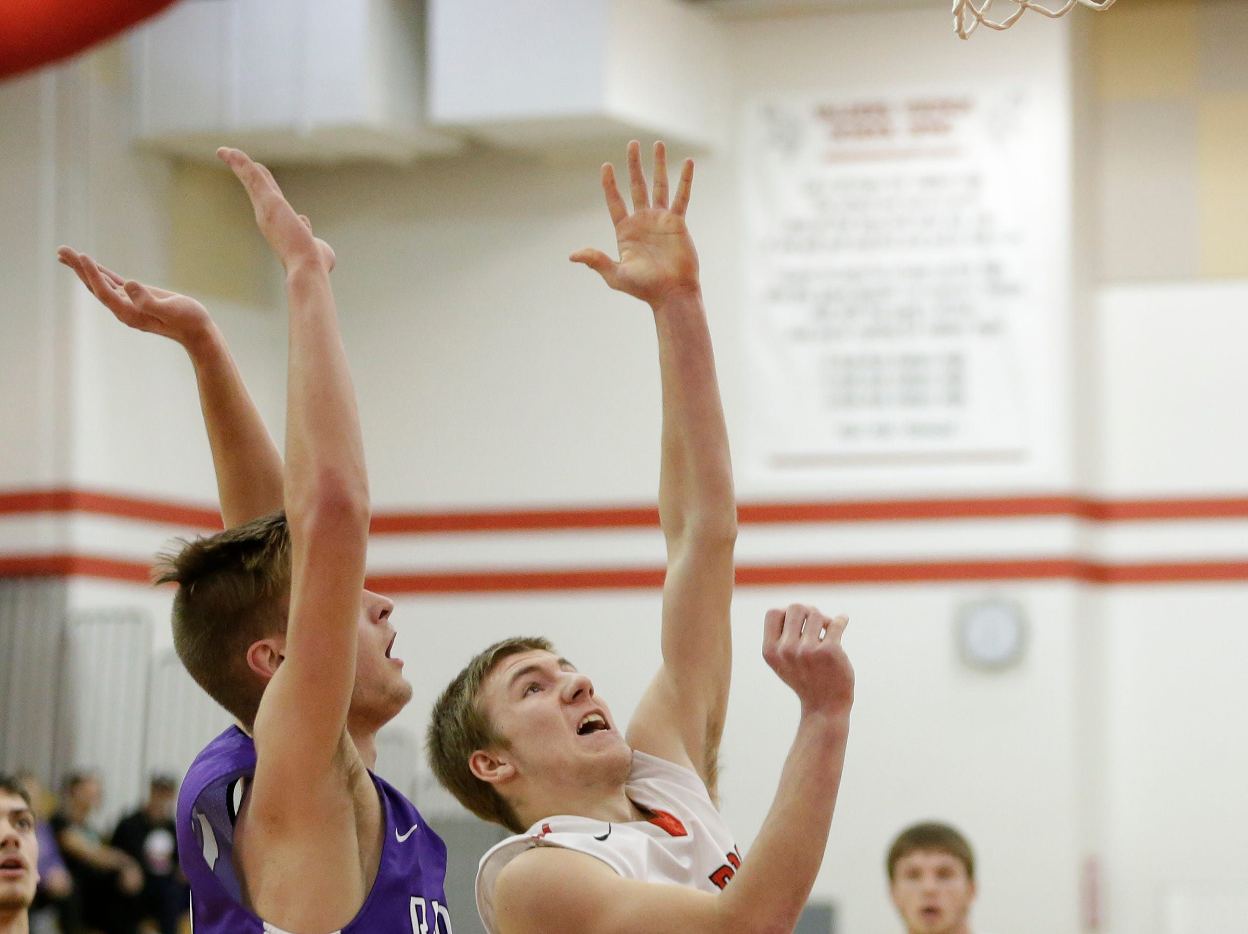 Valders' Trevor Leist (12) shoots against Two Rivers at Valders High School Thursday, January 24, 2019, in Valders, Wis. Joshua Clark/USA TODAY NETWORK-Wisconsin