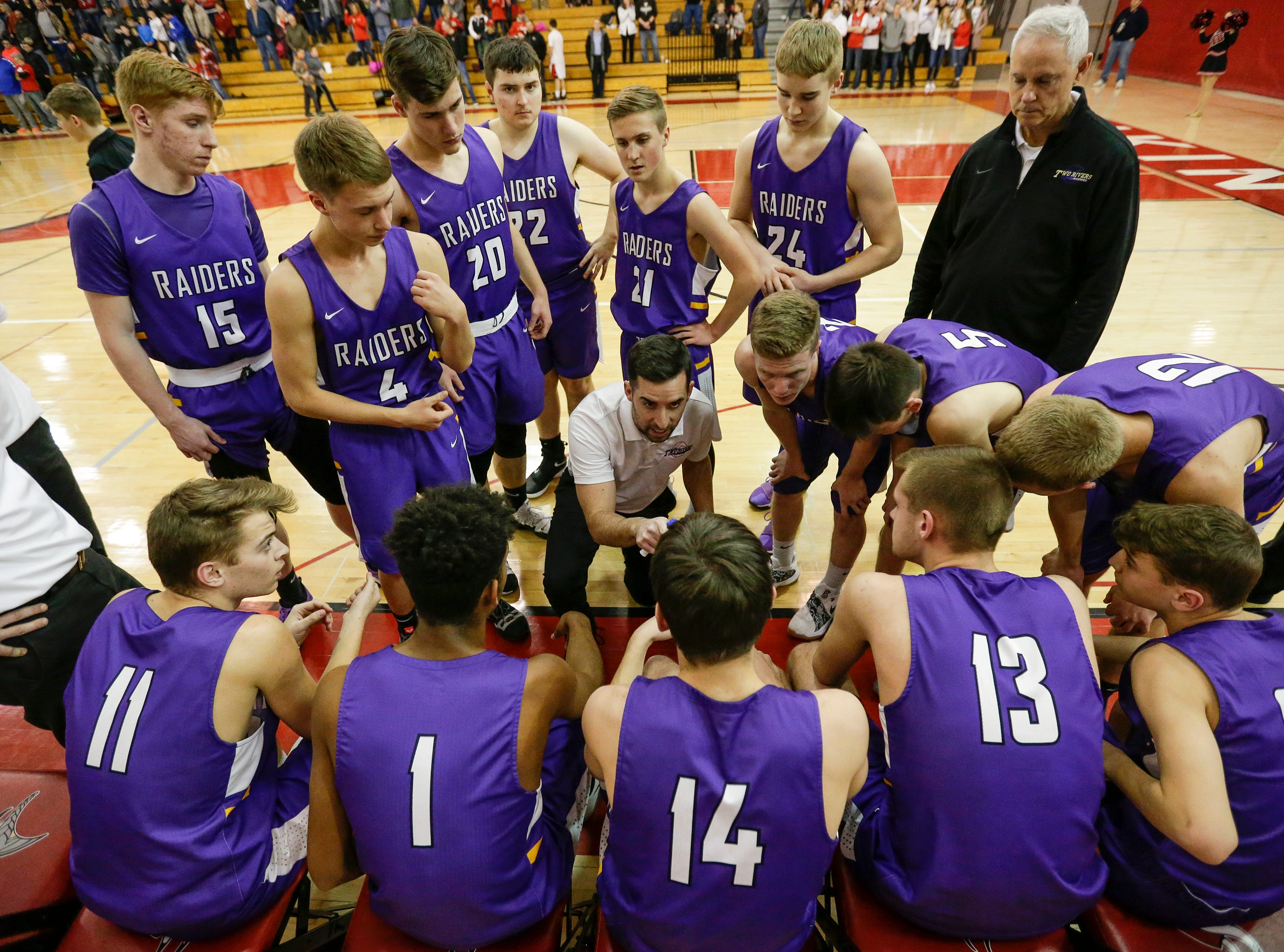 Two Rivers' coach Nick Spencer talks to his team before their game against Valders at Valders High School Thursday, January 24, 2019, in Valders, Wis. Joshua Clark/USA TODAY NETWORK-Wisconsin
