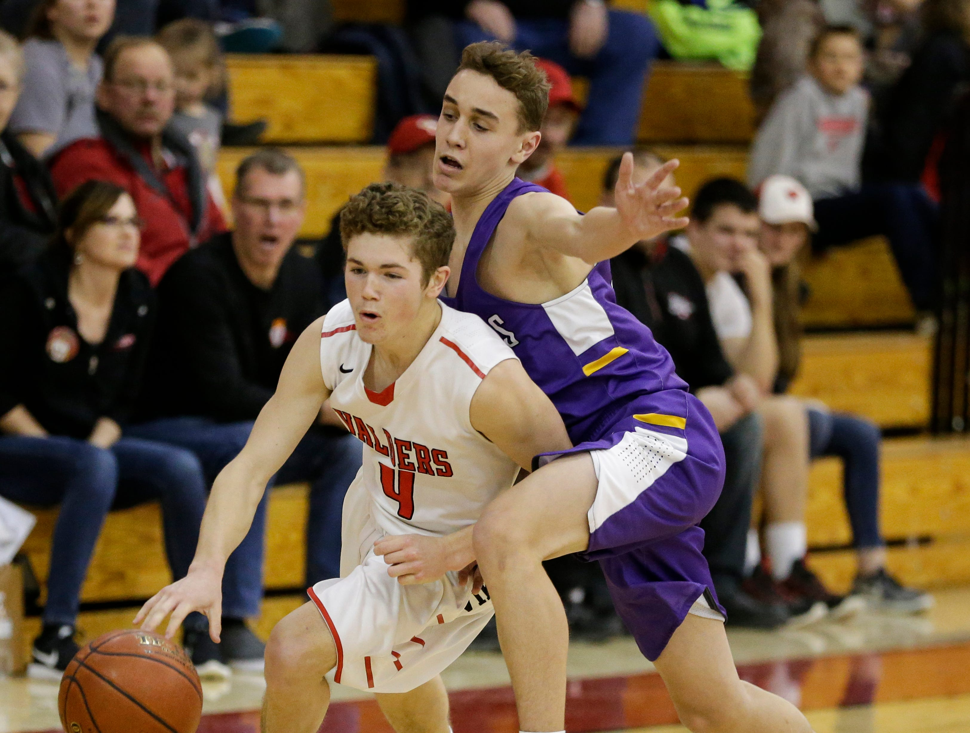 Valders' Nate Griepentrog (4) drives past Two Rivers' Cameron Daffner (3) at Valders High School Thursday, January 24, 2019, in Valders, Wis. Joshua Clark/USA TODAY NETWORK-Wisconsin
