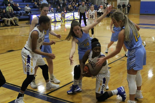 Ontario's Mecca Sewell is surrounded by River Valley's Taylor Hecker and Ally Johnson during the Lady Warriors' loss on Thursday night.