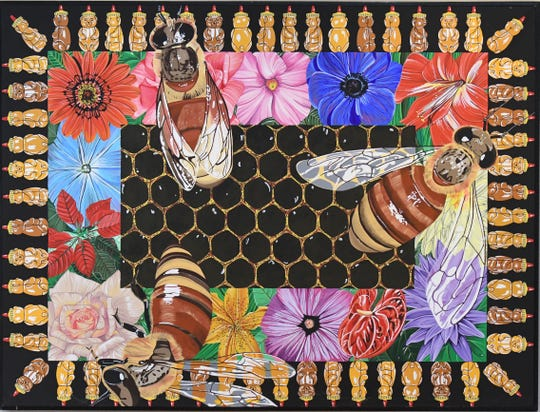 This piece titled Bees by Christine Ellis Donahue and those by her husband Richard Donahue are on display at the Mansfield Art Center.