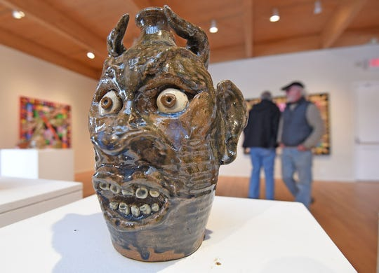 One of the many pieces on display at the Mansfield Art Center is this folk art jug, part of a collection in the Scary Toys, Beasts, Bugs and Jugs exhibit showing until February 24. The collection belongs to Christine Ellis Donahue and Richard Donahue, a couple that are also exhibiting their own works.
