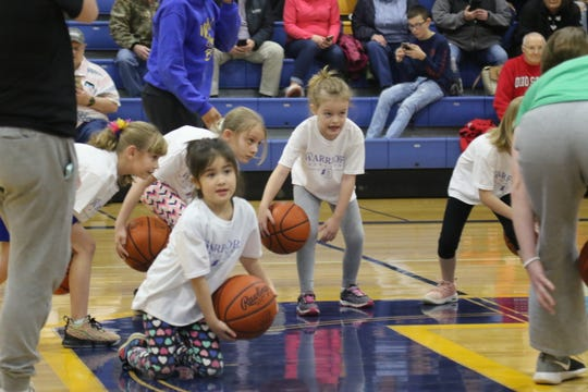Youngsters participated in a skills development camp hosted by the Ontario High School girls basketball program during halftime of the junior varsity game on Thursday night.