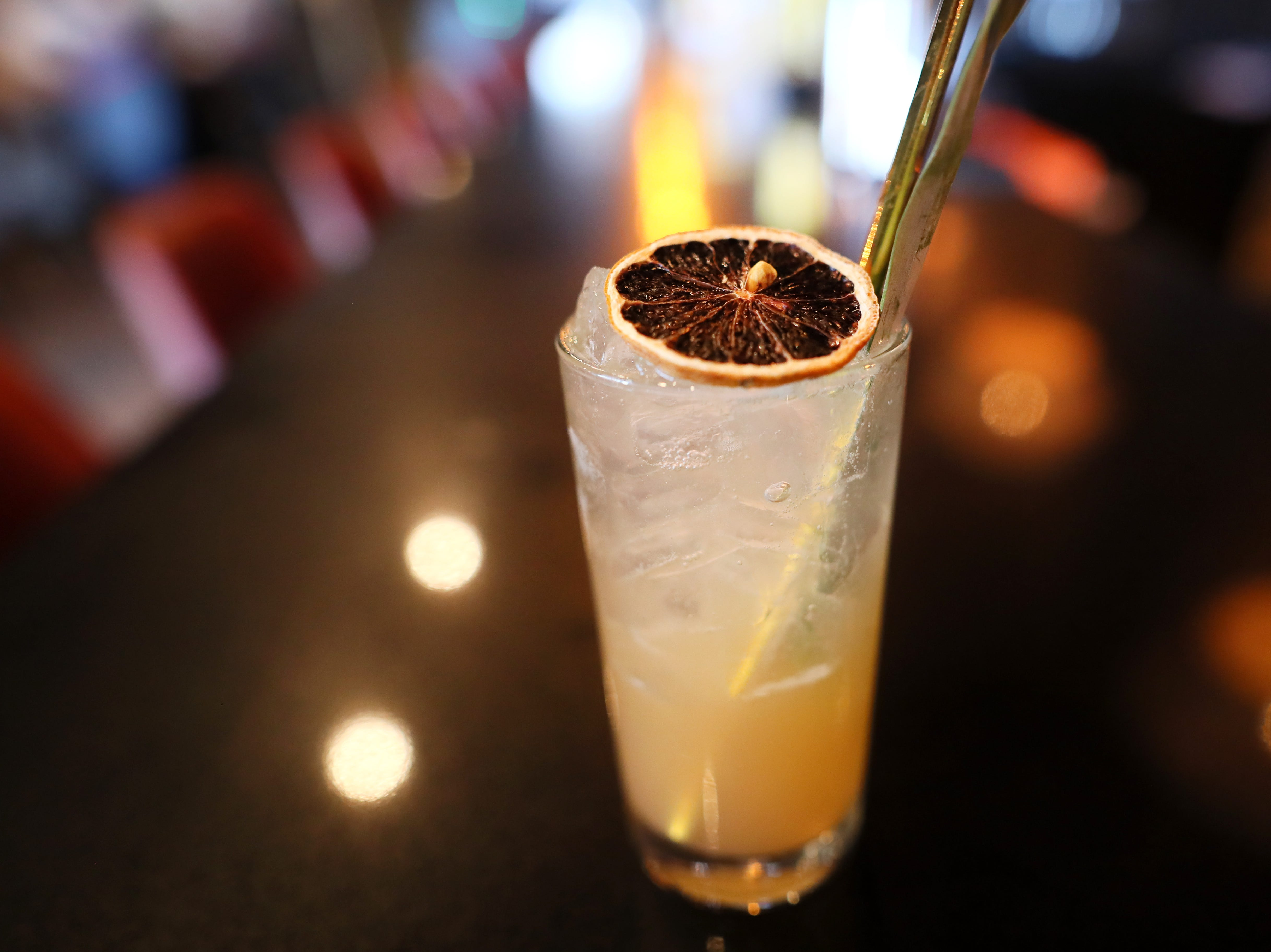 A Kimuri Mirror, red plum and clove shrub, hickory smoked pineapple juice and mineral water with a garnish of dehydrated lemon and pineapple leaf at Lucky Cat, a ramen shop on Broad Avenue which officially opened its door to the public on Friday, Jan. 25, 2019.