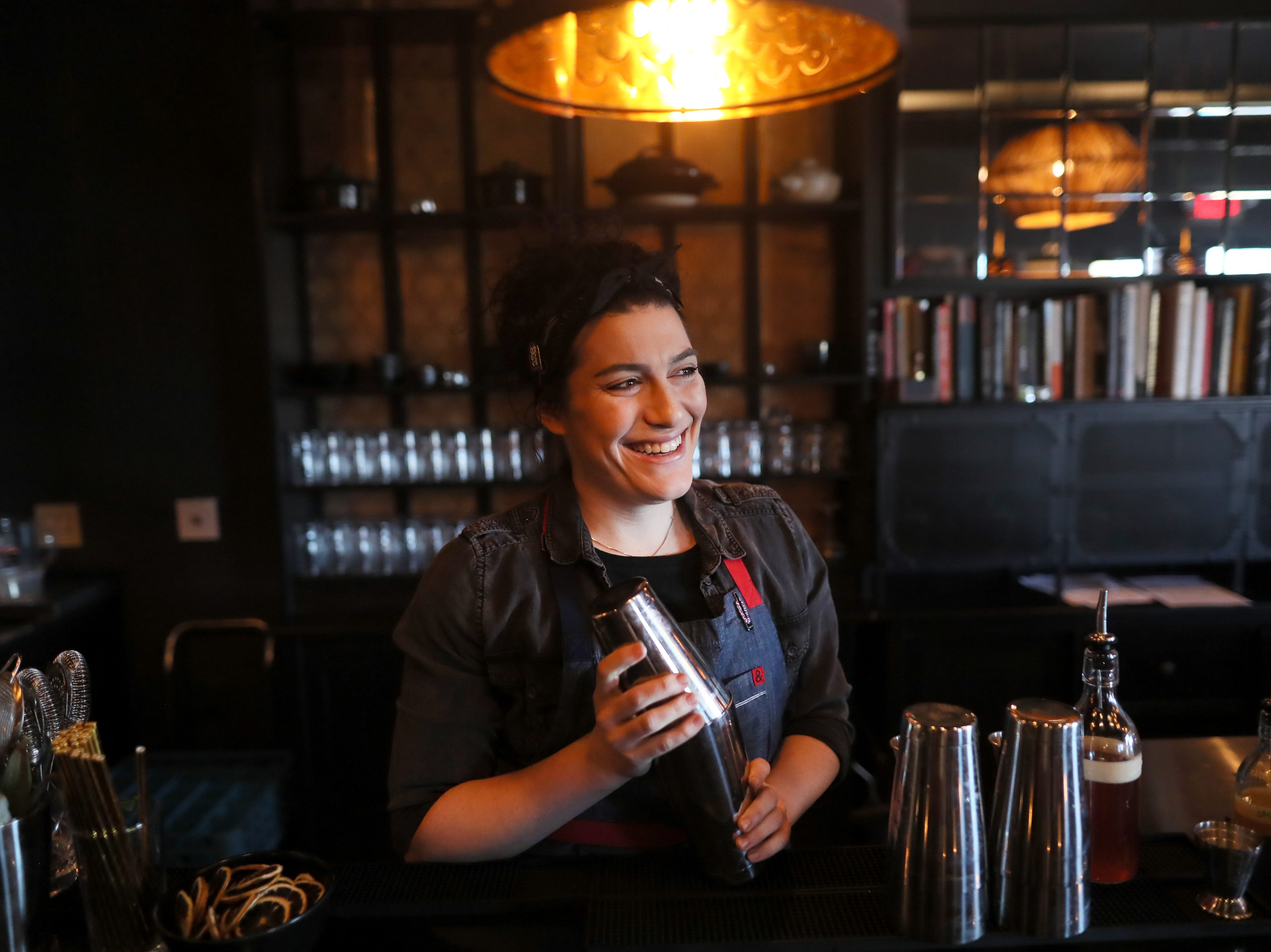 Bartender McKenzie Nelson at Lucky Cat, a ramen shop on Broad Avenue which officially opened its door to the public on Friday, Jan. 25, 2019.