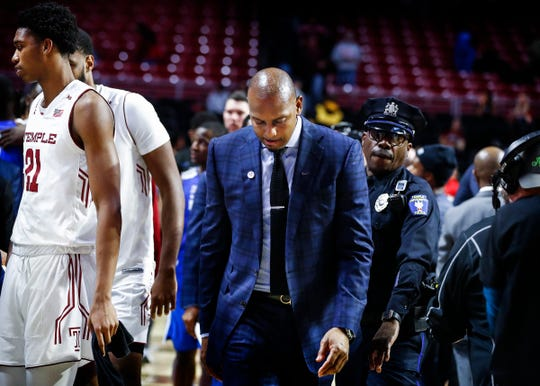 Memphis head coach Penny Hardaway walks off the court after falling to Temple 85-76 in Philadelphia, Thursday, January 24, 2019.