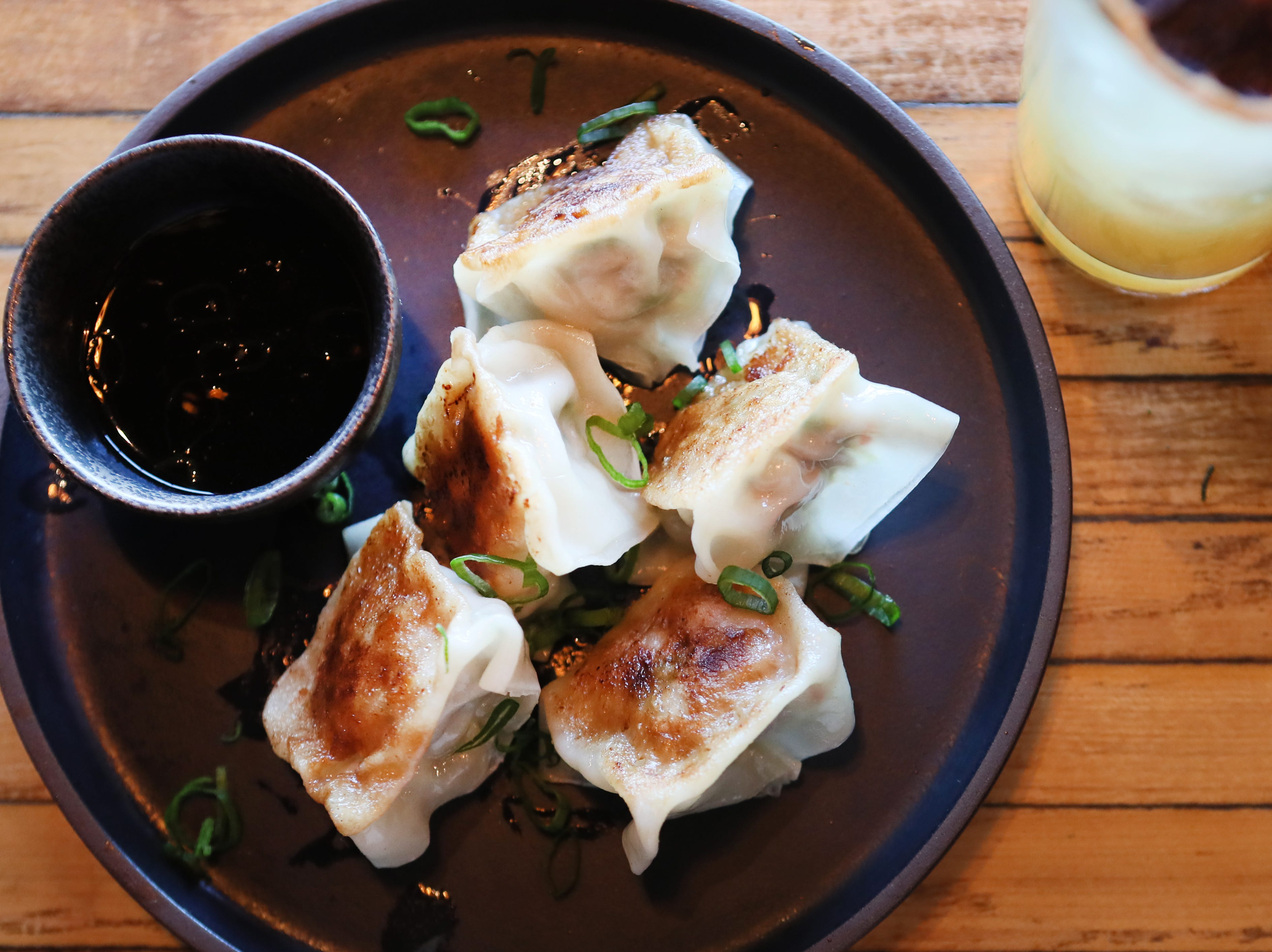 Pork dumplings with ginger, carrots and a scallions garnish at Lucky Cat, a ramen shop on Broad Avenue which officially opened its door to the public on Friday, Jan. 25, 2019.