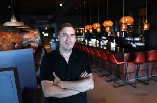 Zach Nicholson is owner and head chef of Lucky Cat, a ramen shop on Broad Avenue that officially opened its doors to the public Jan. 25, 2019.