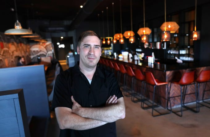 Zach Nicholson, owner and head chef of Lucky Cat, a ramen shop on Broad Avenue which officially opened its door to the public on Friday, Jan. 25, 2019.