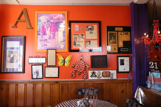 Framed reviews of Alcenia's line the walls of the restaurant.