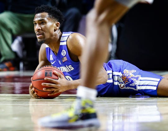 Memphis guard Jeremiah Martin grabs a loose ball during action against Temple in Philadelphia, Thursday, January 24, 2019.