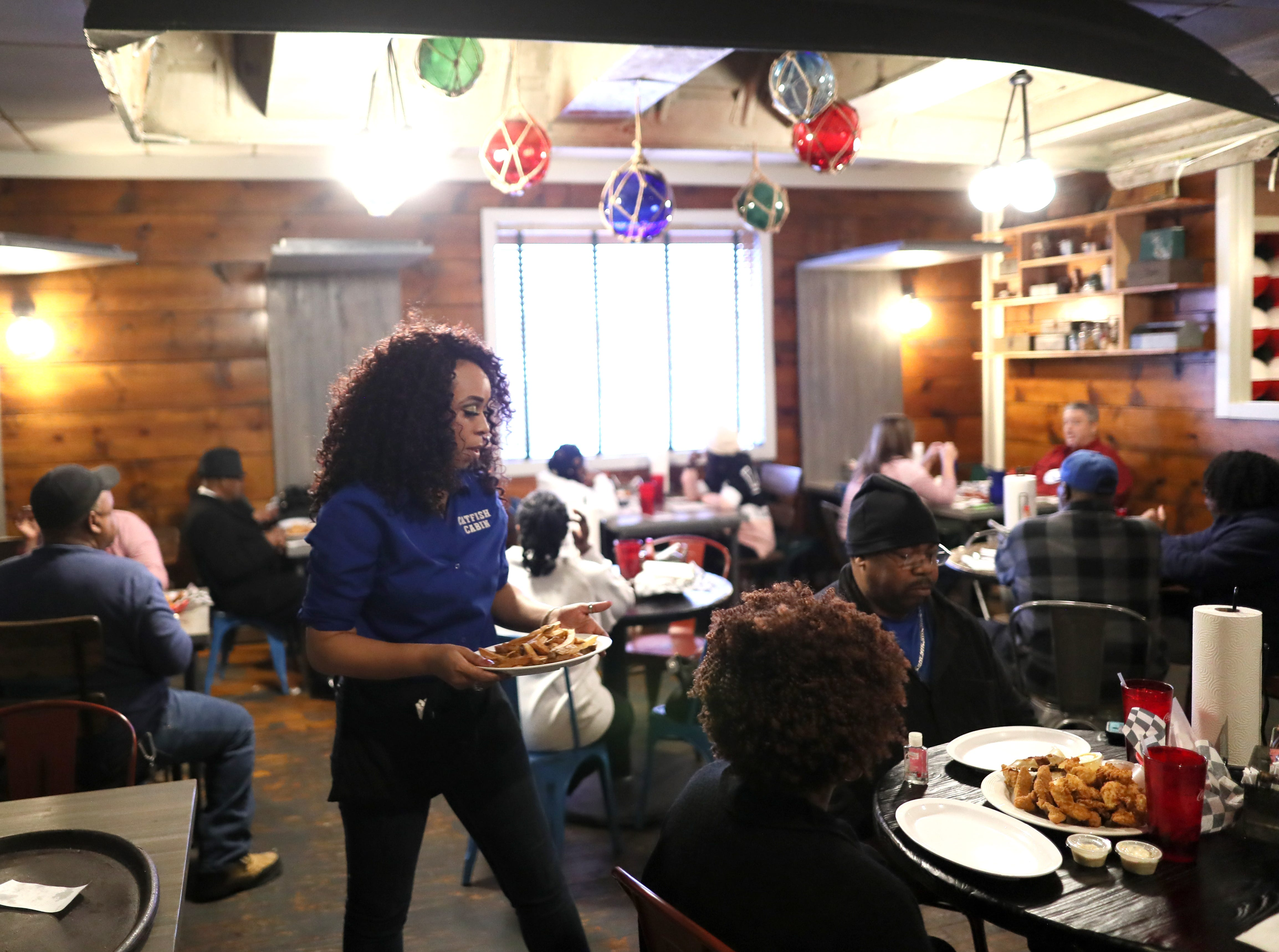 Customers sit for an early dinner on Friday at Catfish Cabin, which recently appeared on an episode of Gordon Ramsay's 24 Hours to Hell and Back television show.