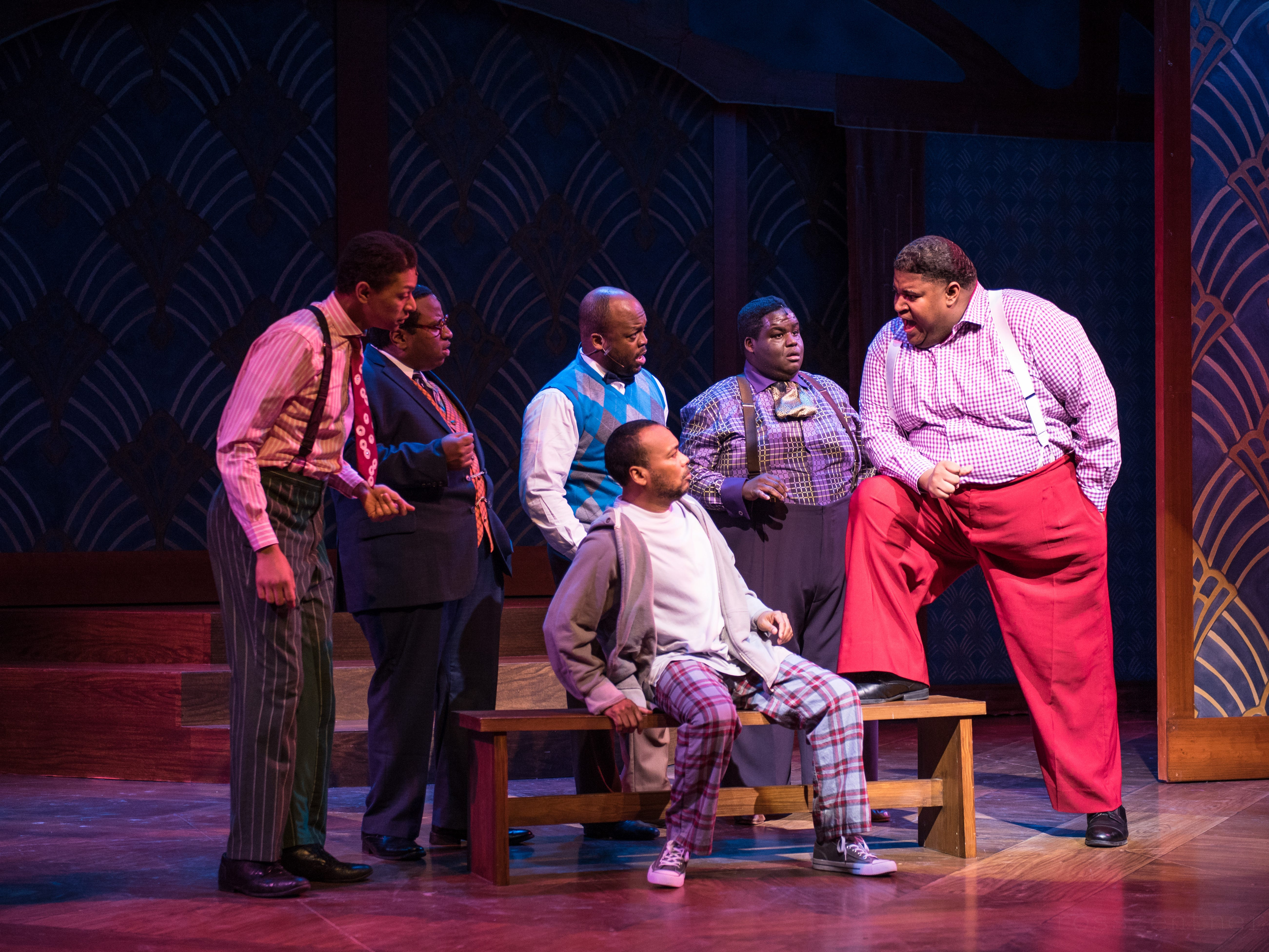 """Big Moe (Lorenzo Rush Jr., right) makes a point to Nomax (Gavin Lawrence, on bench) in Skylight Music Theatre's production of """"Five Guys Named Moe,"""" as Eat Moe (Sean Anthony Jackson), Four-Eyed Moe (James Carrington), No Moe (Shawn Holmes) and Little Moe (Kevin James Sievert) look on."""