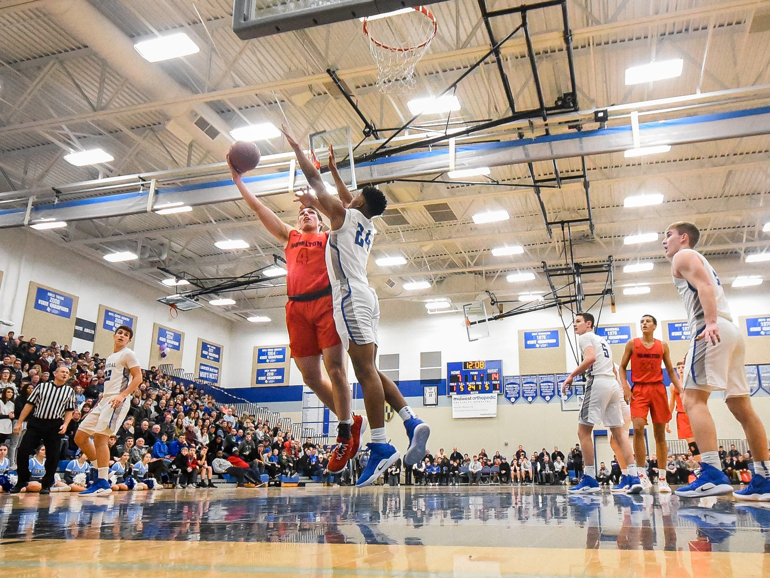 Sussex Hamilton forward/center Lucas finnessy goes to the basket against Brookfield Central forward David Joplin in a boys basketball game Thursday, January 24, 2019, at Brookfield Central High School.