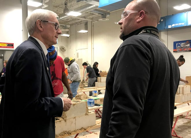 Gov. Tony Evers spoke with Kevin Kroll, a bricklaying instructor, Friday during a visit to the Milwaukee Area Technical College facilities on National Avenue, where Evers toured that and other apprenticeship programs.