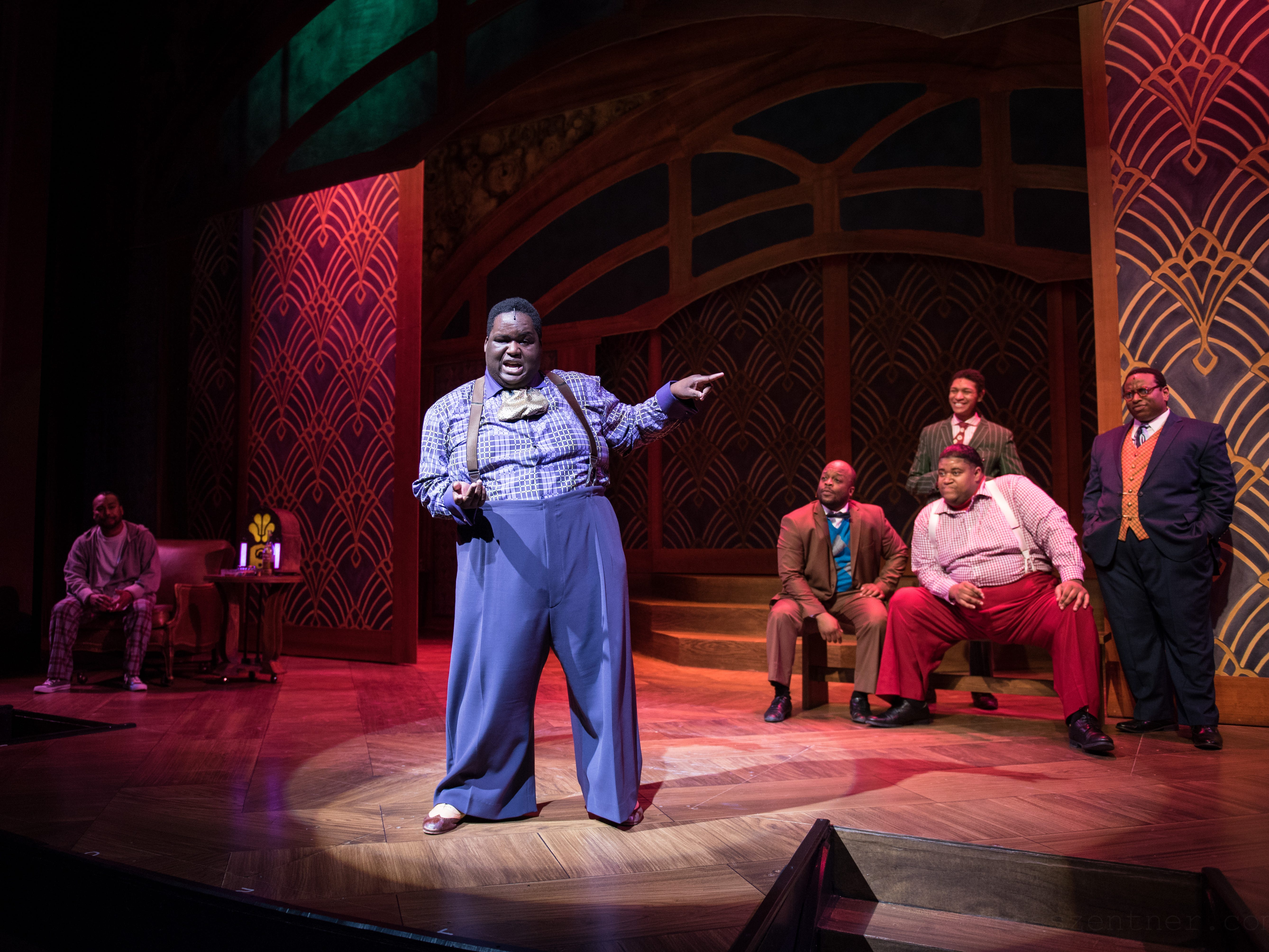 """Little Moe (Kevin James Sievert) takes the spotlight in a scene from Skylight Music Theatre's """"Five Guys Named Moe."""" Looking on: Gavin Lawrence (from left), Shawn Holmes, Sean Anthony Jackson, Lorenzo Rush Jr. and James Carrington."""