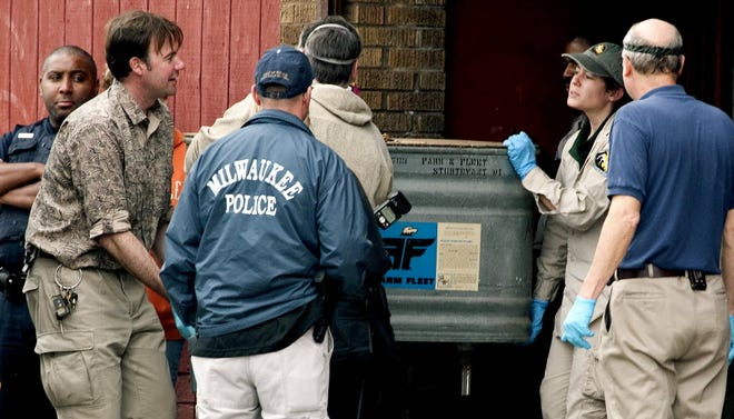 Authorities take animals from Terry Cullen's building on South 13th Street in Milwaukee in May 2010.