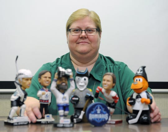 Gail Burchardt was scheduled to attend her 1,000 consecutive Milwaukee Admirals home game Friday, Jan. 25. This photo from 2016 shows her at work with her Admirals memorabilia, after the Admirals awarded her a plaque for No. 900.