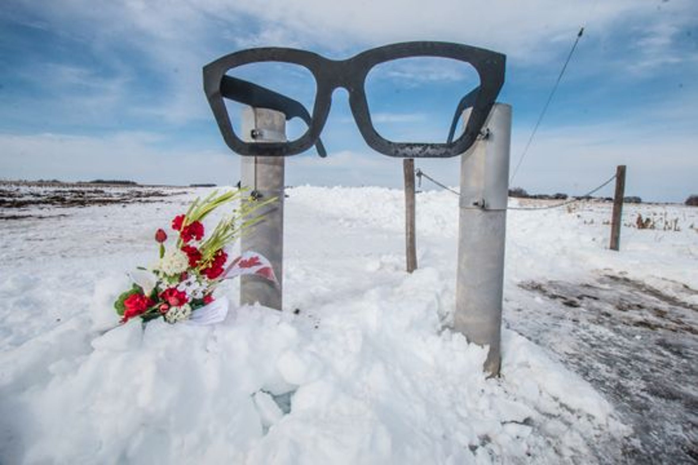 Black eyeglasses mark the trek to the site of a 1959 plane crash that killed Buddy Holly, The Big Bopper, Ritchie Valens and the pilot. The site in Clear Lake, Iowa, and the Surf Ballroom where the trio performed, remain famous as the 60th anniversary of the crash approaches Feb. 3.