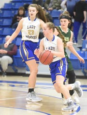 Mountain Home's Abigail Hodges drives to the basket during the Junior Lady Bombers' 37-27 loss to Greene County Tech on Thursday night.
