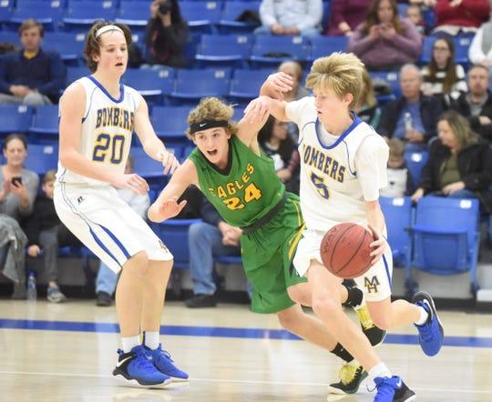Mountain Home's Luke Proctor dribbles around a Greene County Tech defender Thursday night.