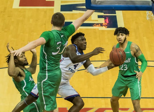 Louisiana Tech's Daquan Bracey (4) attempts to make a lay-up while Marshall's Mikel Beyers (31) attempts to make a block during the game at the Thomas Assembly Center in Ruston, La. on Jan 24.
