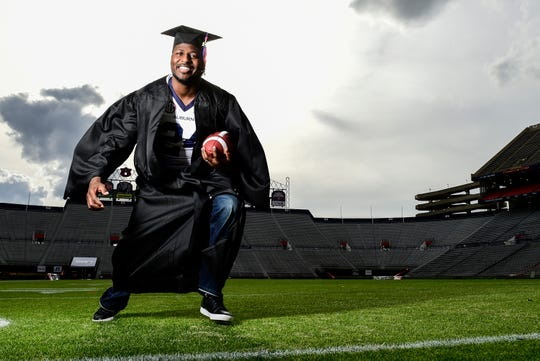 "Former Auburn running back Carnell ""Cadillac"" Williams graduates on Dec. 3, 2014."