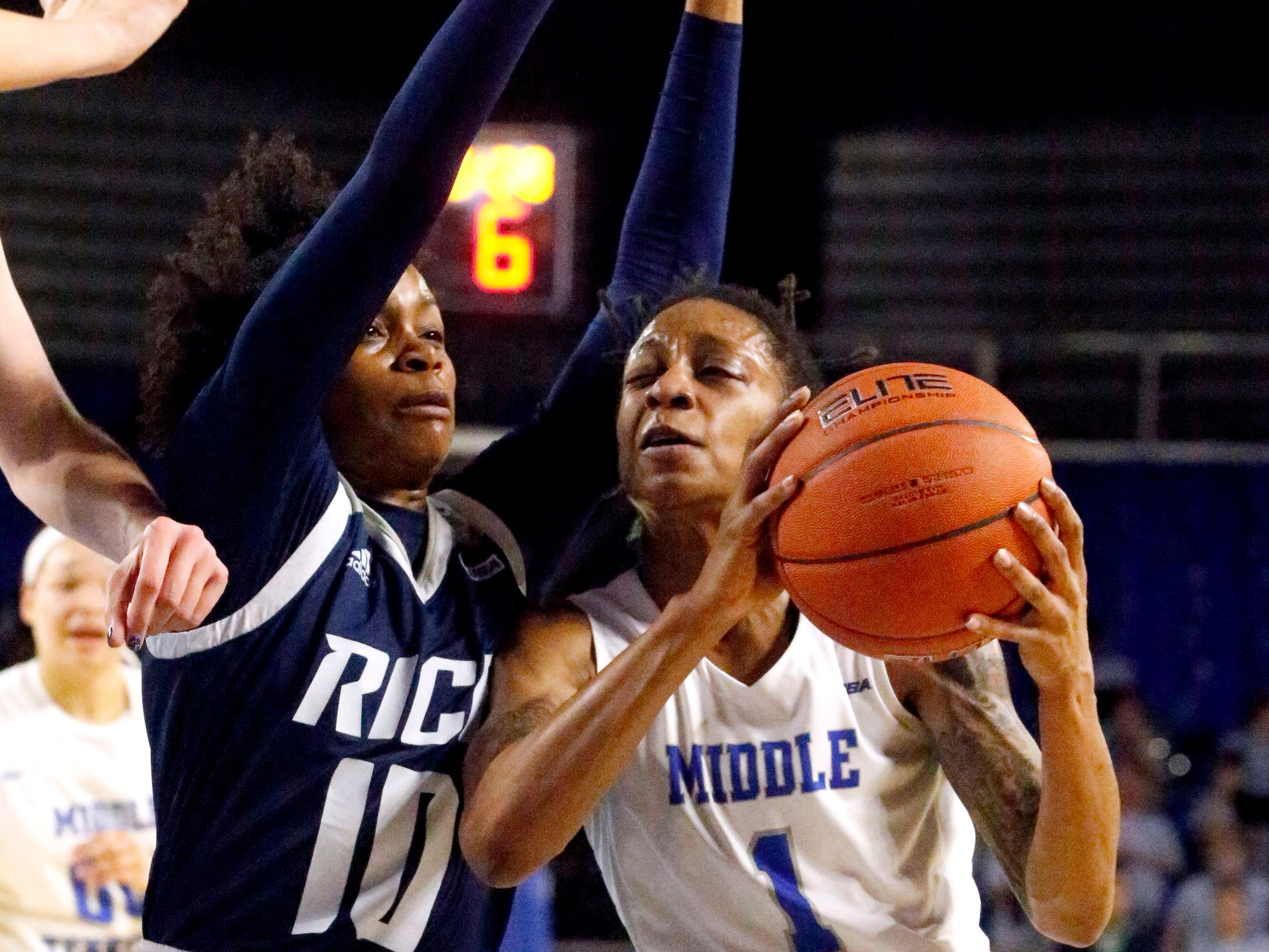 MTSU's guard A'Queen Hayes (1) pushes toward the basket as Rice's guard Jasmine Smith (10) guards her on Thursday Jan. 24, 2019.