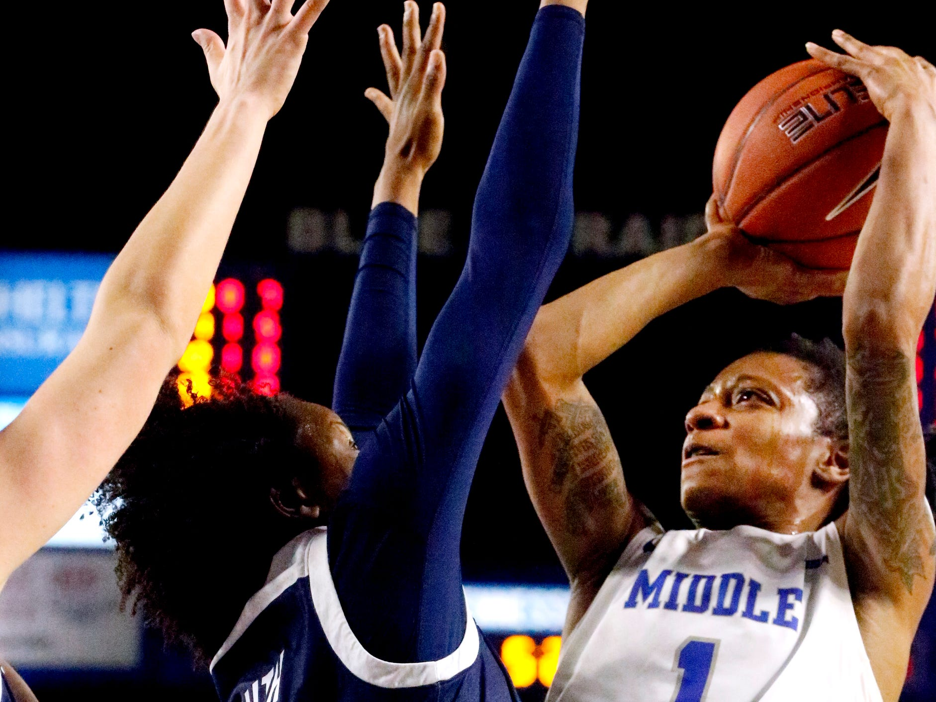 MTSU's guard A'Queen Hayes (1) shoots the ball as Rice's guard Jasmine Smith (10) guards her on Thursday Jan. 24, 2019.