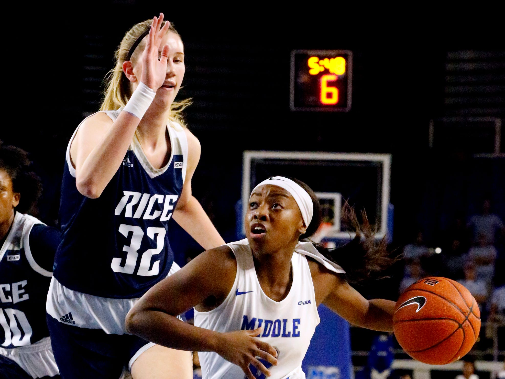 MTSU's guard Taylor Sutton (2) drives to the basket as Rice's center Nancy Mulkey (32) guards her on Thursday Jan. 24, 2019.