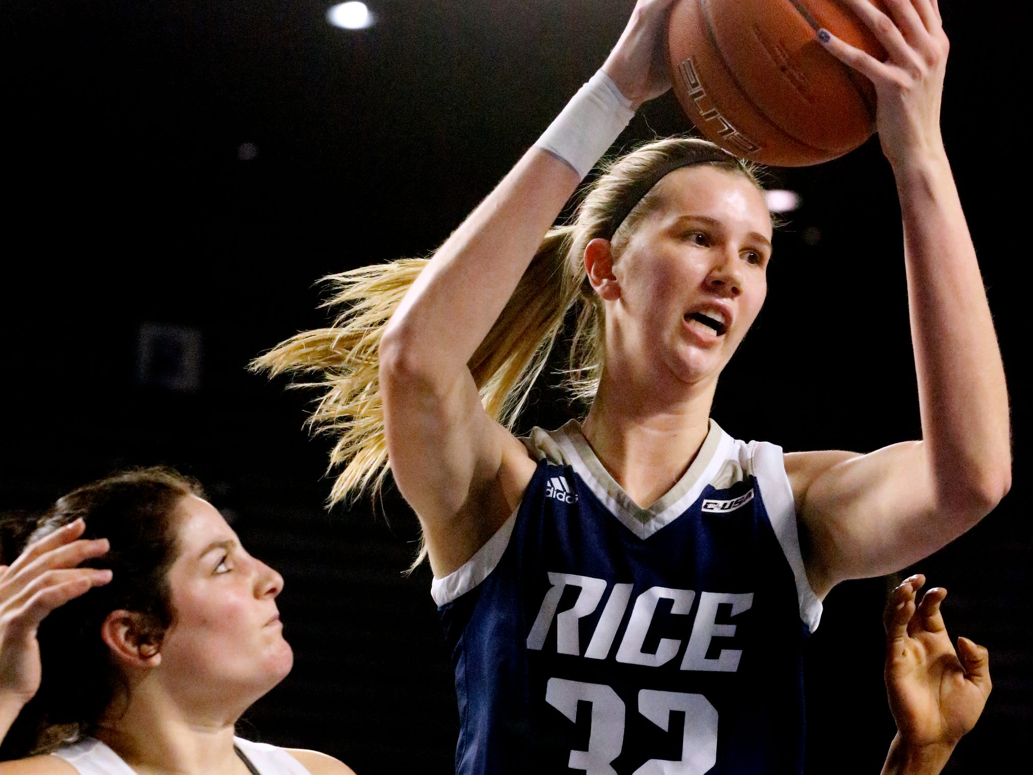 Rice's center Nancy Mulkey (32) grabs a rebound as MTSU's guard Jess Louro (12) also goes for the ball on Thursday Jan. 24, 2019.